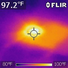 thermal of can light from interior space shows hot air coming from attic