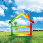 Illustration of a rainbow-colored home on top of an image of a grassy field on a sunny day.