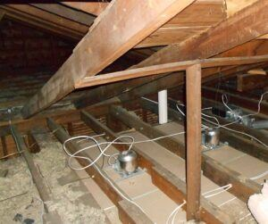 attic with missing and low insulation